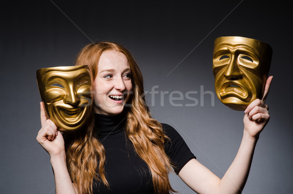 Redhead woman iwith masks in hypocrisy consept against grey back Stock photo © Elnur