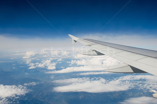 Airplane wing out of window Stock photo © Elnur