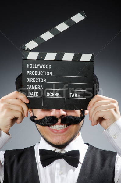 Funny man with movie clapper board  Stock photo © Elnur
