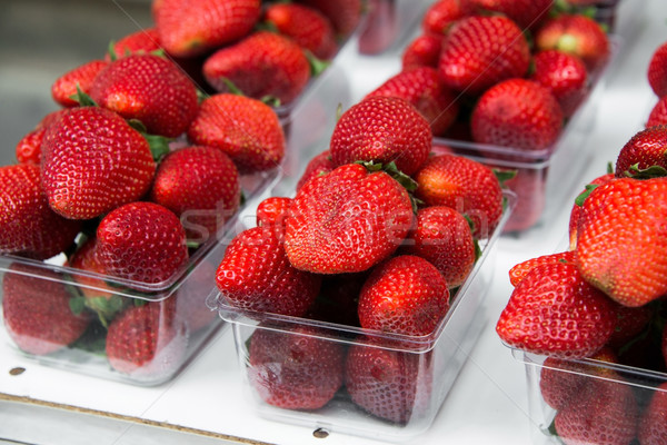 Strawberries in boxes as healthy food on sale Stock photo © Elnur