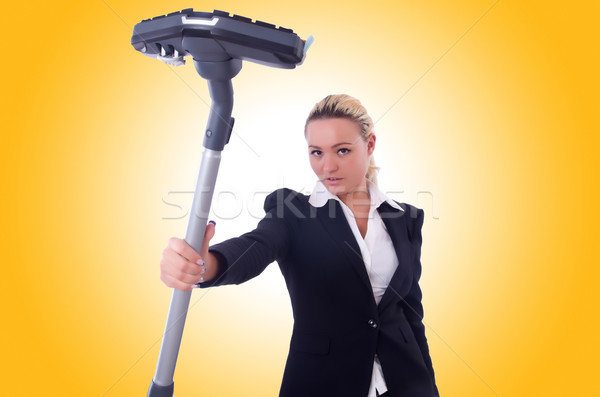 Businesswoman with vacuum cleaner on white Stock photo © Elnur