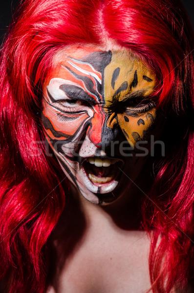 Mulher tigre cara halloween moda gato Foto stock © Elnur