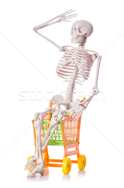 Skeleton with shopping cart trolley isolated on white Stock photo © Elnur