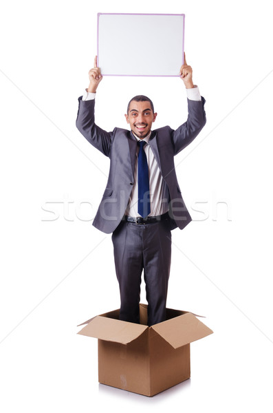 Businessman standing in the box isolated on white Stock photo © Elnur