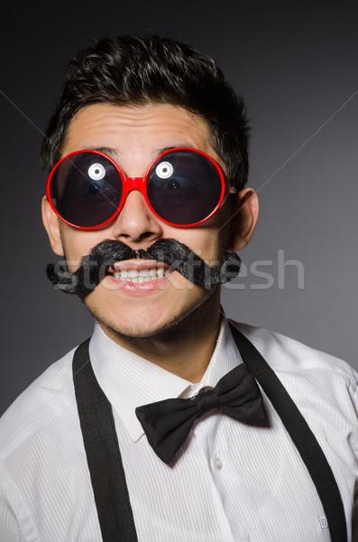 Jeune homme faux moustache isolé gris homme Photo stock © Elnur