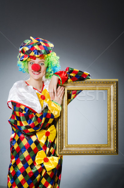 Clown with picture frame in funny concept Stock photo © Elnur