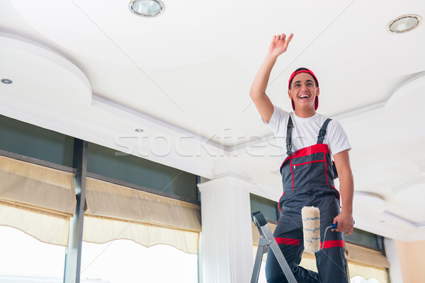 Young painter painting the ceiling in construction concept Stock photo © Elnur