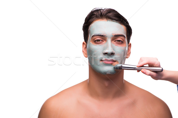 The man with face mask being applied on white Stock photo © Elnur