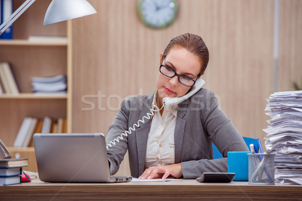 Busy stressful woman secretary under stress in the office Stock photo © Elnur