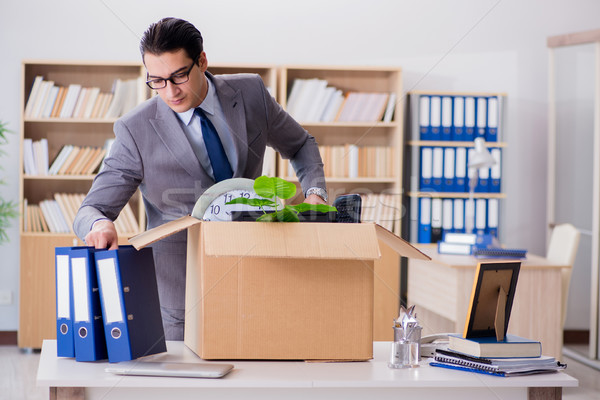 The man moving office with box and his belongings Stock photo © Elnur