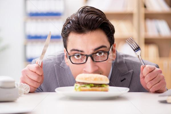 飢えた 面白い ビジネスマン 食べ サンドイッチ ストックフォト © Elnur