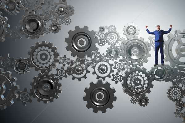 Businessnman in teamwork concept with cogwheels Stock photo © Elnur