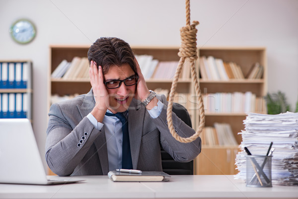 Stock photo: Bankrupt broke businessman considering suicide hanging himself