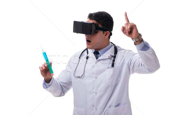 Doctor wearing a vr virtual reality headset isolated on white ba Stock photo © Elnur