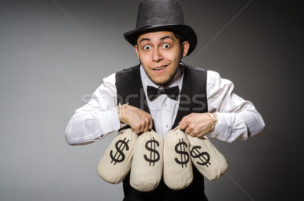 Man with sacks of money Stock photo © Elnur