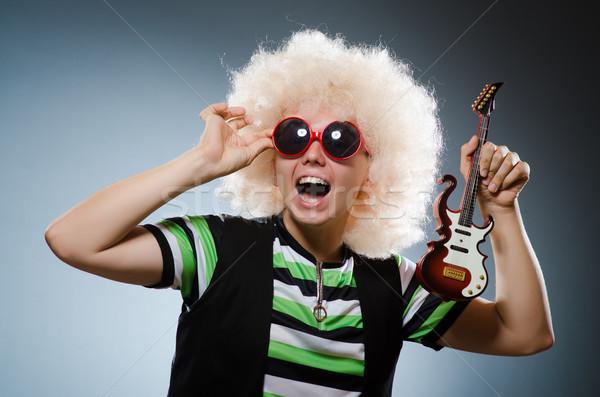 Funny człowiek miniatura gitara muzyki strony Zdjęcia stock © Elnur