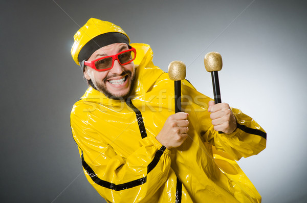 Man wearing yellow suit with mic Stock photo © Elnur