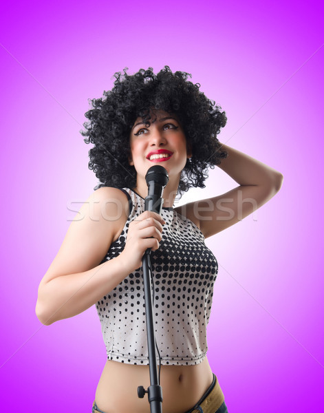 Pop star with mic  on white Stock photo © Elnur