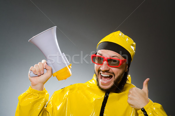 Man wearing yellow suit with loudspeaker Stock photo © Elnur