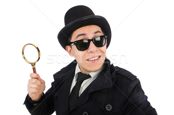 Young detective in black coat holding magnifying glass isolated  Stock photo © Elnur