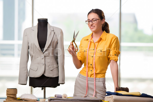 Woman tailor working on new clothing Stock photo © Elnur