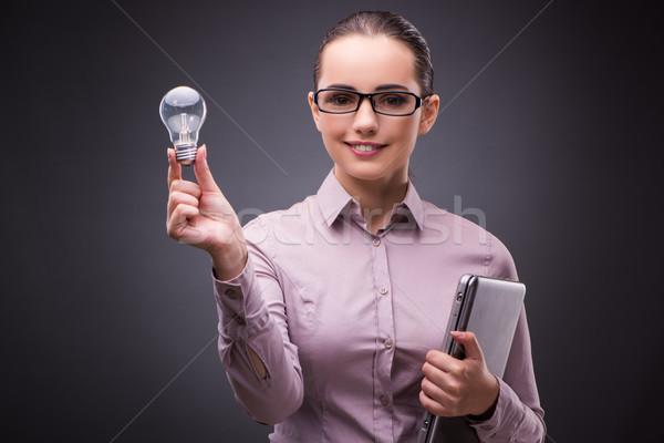 Mujer de negocios bombilla creatividad negocios mano Foto stock © Elnur