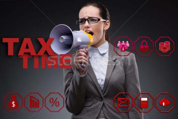 Businesswoman in business tax concept Stock photo © Elnur