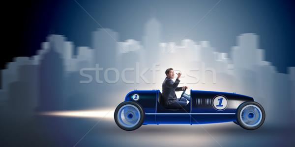 The businessman riding vintage roadster in motivation concept Stock photo © Elnur