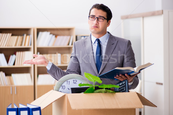 The young businessman moving offices after being made redundant Stock photo © Elnur