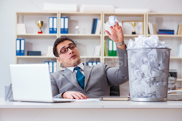 Businessman in paper recycling concept in office Stock photo © Elnur