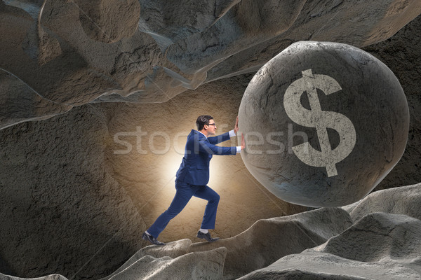 Businessman pushing dollar sign in business concept Stock photo © Elnur