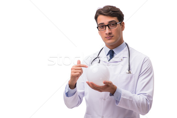 Doctor with crystal ball isolated on white background Stock photo © Elnur