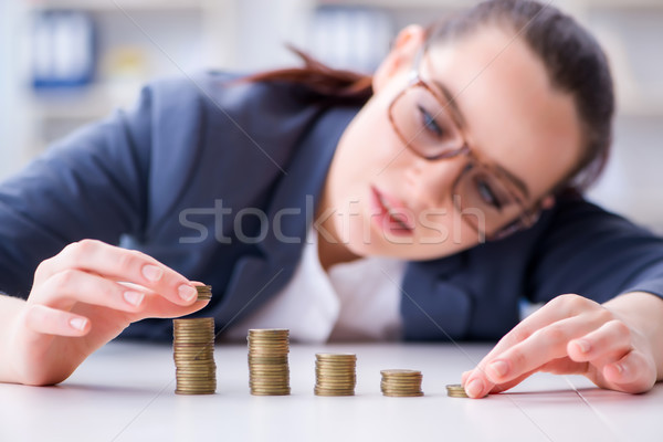 Businesswoman with coins in forex concept Stock photo © Elnur
