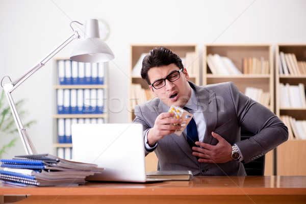 The businessman feeling pain in the office Stock photo © Elnur