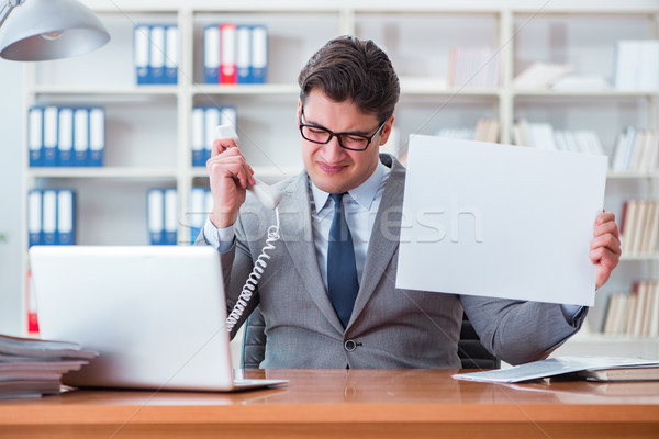 Businessman  in office holding a blank message board Stock photo © Elnur