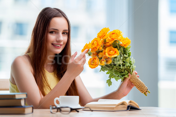 Young girl with present of flowers Stock photo © Elnur
