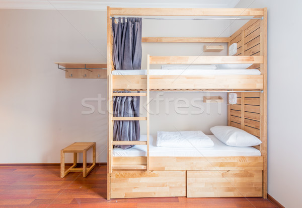 Hostel dormitory beds arranged in room Stock photo © Elnur