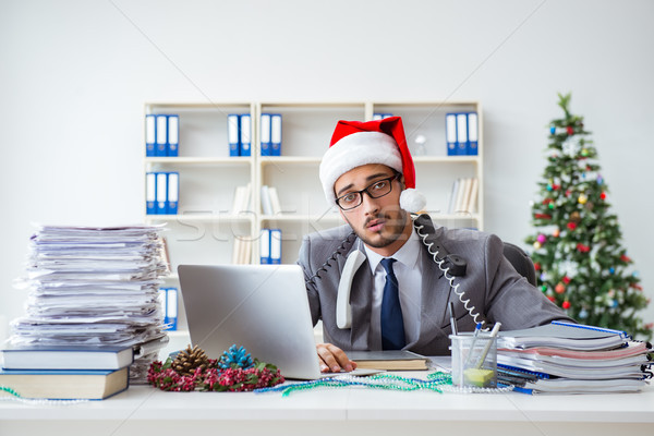 Young businessman celebrating christmas in the office Stock photo © Elnur