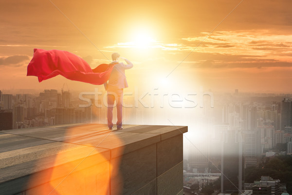 Super hero businessman  on top of building ready for challenge Stock photo © Elnur