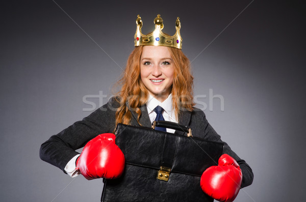 Woman boxer with crown and red gloves Stock photo © Elnur