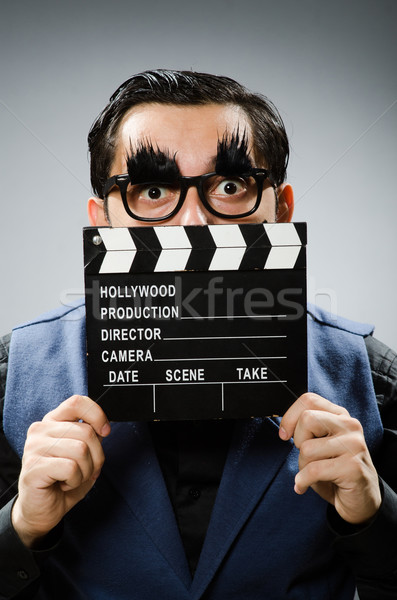 Funny man holding movie clapper Stock photo © Elnur