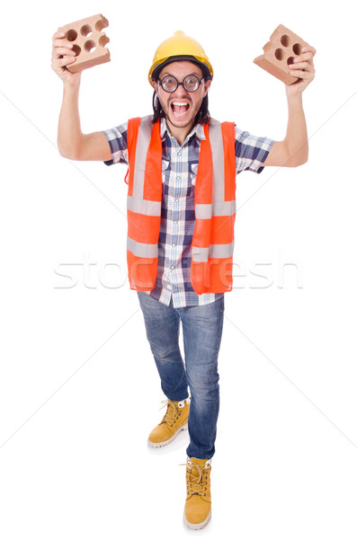 Funny young construction worker with broken brick isolated on white Stock photo © Elnur