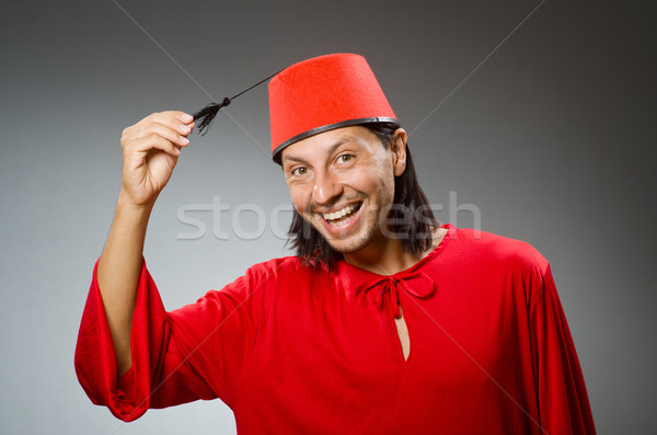 Funny man in red dress wearing fez hat Stock photo © Elnur