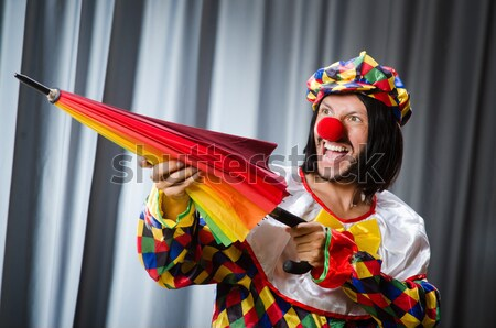 Funny clown with red axe Stock photo © Elnur