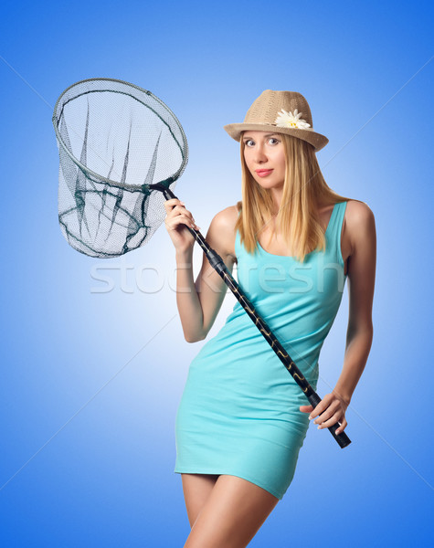 Attractive woman in butterfly catch Stock photo © Elnur