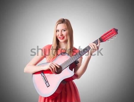 Csinos fiatal lány vörös ruha fegyver izolált fehér Stock fotó © Elnur