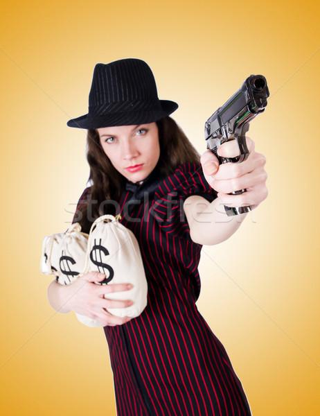 Kadın gangster tabanca beyaz seksi model Stok fotoğraf © Elnur