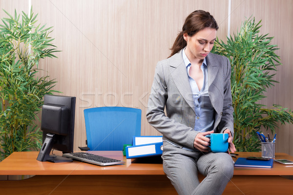 Woman under stress working in the office Stock photo © Elnur