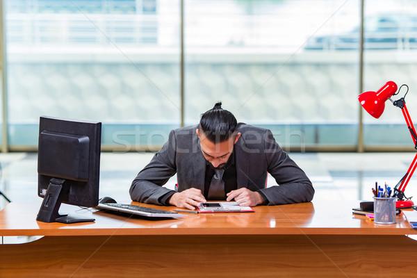 Sad businessman sitting in the office Stock photo © Elnur