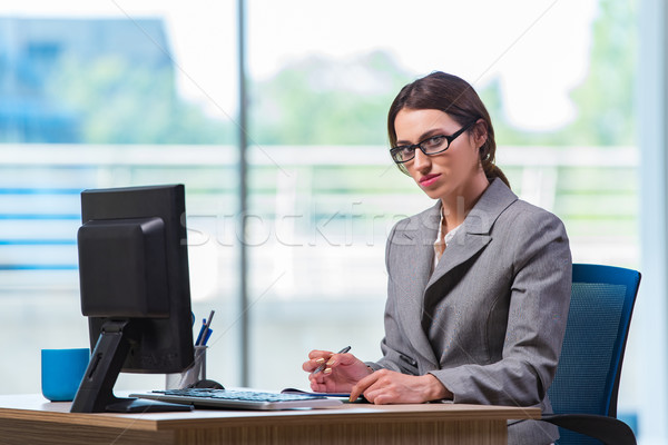 Young businesswoman tired after long working day Stock photo © Elnur